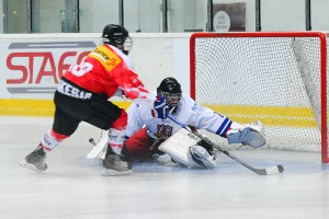Vítek Vaněček stopping Swiss forward Denis Malgin in shootout. Photo by Eva Solaříková
