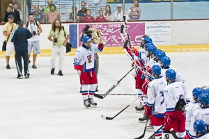 Under-18 national team captain Dominik Mašín bringing the cup for bronze-medal game win to his teammates at the Ivan Hlinka Memorial Tournament in Břeclav. Photo by Roman Kantor
