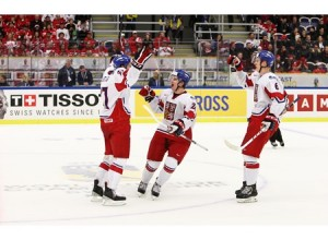 Michal Plutnar celebrating his goal against Canada with teammates. Photo courtesy of IIHF.