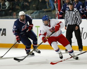 David Pastrňák carrying the puck during the final game at the U18 World Juniors in Finland. Photo courtesy of IIHF.